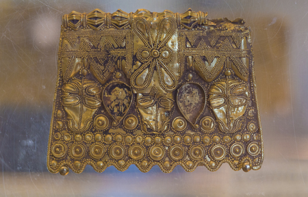 Badajoz, Spain - November 21, 2017: La Martela Hoard golden plate dated at 2nd Iron Ages. Badajoz Archaeological Museum