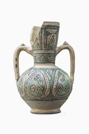 Jaen, Spain - December 29th, 2017: Moorish jar made of glazed clay technique found at Mengibar, Jaen. XII Century.  Jaen Museum Imagens - 99493719