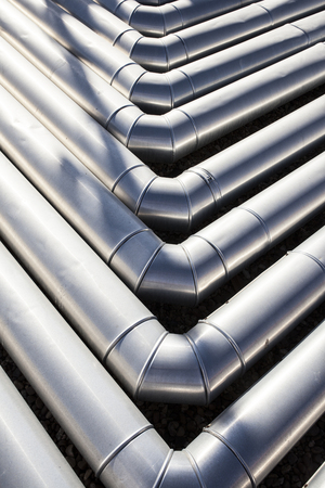 Pipes for heating and air conditioning recuperator at building roof. Corner elbow joints Stock Photo