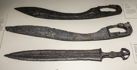Madrid, Spain - November 10th, 2017: Three Iberian ancient swords at National Archeological Museum of Madrid Editorial