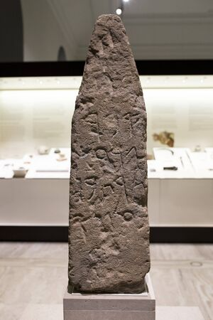 Madrid, Spain - November 10, 2017: Stele from Villaricos with phoenician signs at National Archaeological Museum
