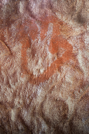 Caceres, Spain - May 27th, 2018: Maltravieso Cave replica with Neanderthals four fingers hand-prints, Caceres, Spain