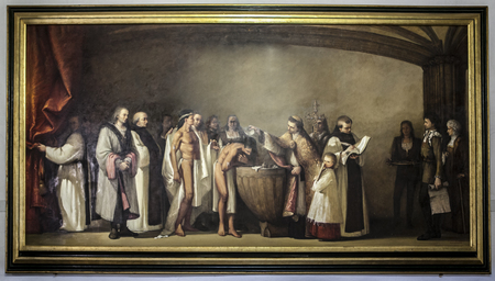 Guadalupe, Spain - February 27, 2017: Painting of the Baptism of Native American Indians brought to Spain by Columbus by Juan Manuel Nu? ? ez Ba? ? ez, painter