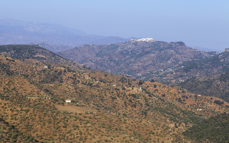Aerial view of Comares, white village up on the hill of Malaga mountains, Andalusia, Spain. Panoramic