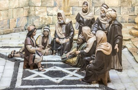 Badajoz, Spain - December 2017: Christmas Nativity scene. The Boy Jesus at the Temple. Built by Local Association of Friends of Cribs of Badajoz Editorial