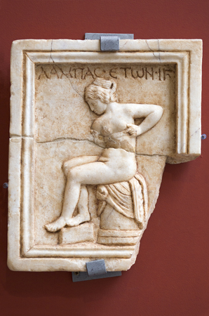 Merida, Spain - December 20th, 2017: Postitute relief plaque at National Museum of Roman Art in Merida, Spain