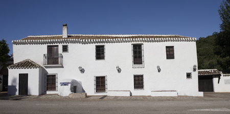 Montes de Malaga, Spain - July 8th, 2018: Alfarnate hosterly the oldest Andalusian inn active. Famous brigands shelter during 18-19th century