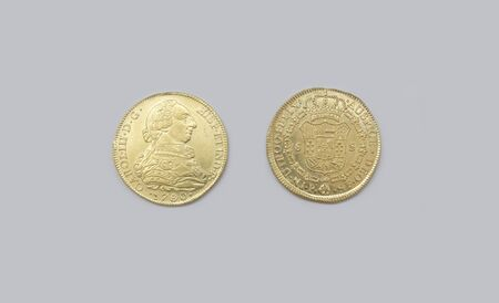 Cartagena, Spain - September 14th, 2018: Gold spanish pieces of eight or Charles III escudos, minted in 1780 at ARQUA Museum, Spain