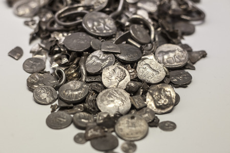 Malaga, Spain - Sept 21th, 2018: Hoard of Cerro Colorado, oldest coins ever made in iberia. Malaga Museum, Spain Stock Photo