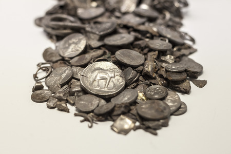 Malaga, Spain - Sept 21th, 2018: Hoard of Cerro Colorado, oldest coins ever made in iberia. Malaga Museum, Spain Editorial