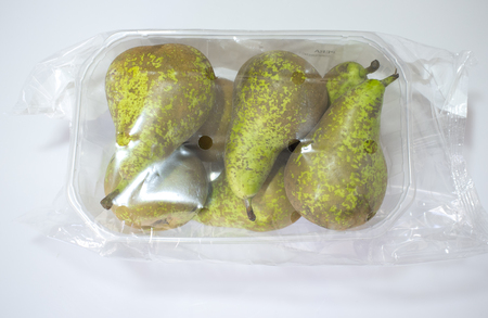 Conference pears on their plastic package covered. Closeup