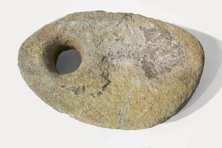 Huelva, Spain - July 02, 2018: Ancient stone phoenician boat anchor. Museum of Huelva, Andalusia, Spain