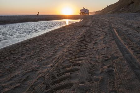 Last swimmers close to Chiringuito beach at sunset, Costa de la Luz seashore, Matalascanas, Huelva. Sunset
