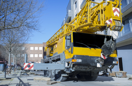 Mobile crane at construction site. Mounting crane process