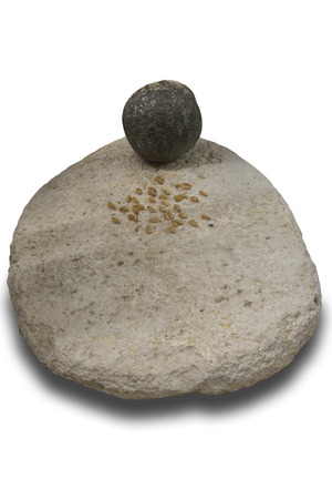 Neolithic era simple mill stone. Isolated over white background