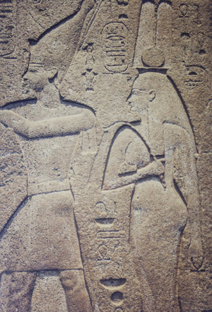 London; UK - April 14th; 2002: Red granite temple-relief; temple at Bubastis; showing relief representations of Osorkon II and Karoma; his wife. British Museum; UK. Digitise film photo