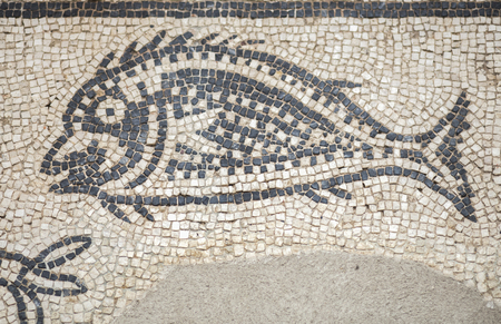 Merida, Spain - December 20th, 2017: Baritto pond mosaic depicting dolphins and breams. National Museum of Roman Art in Merida, Spain Редакционное