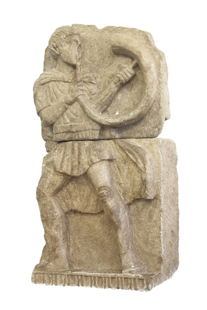 Osuna, Spain - April 20th, 2019: Horn player from Osuna. Iberian culture high relief. Replica at Osuna Archaeological Museum, Seville
