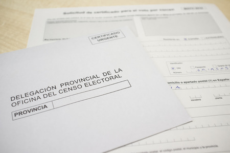 Mature man filling request for absentee vote or postal vote. 2019 Spanish general election