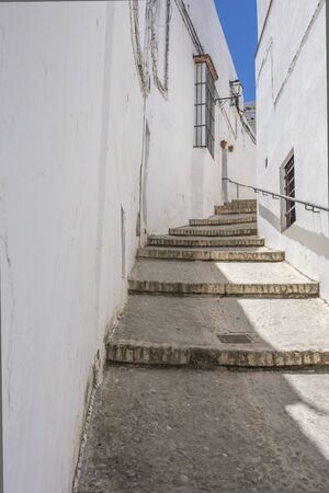 White village Arcos de la Frontera, Cadiz, Andalusia, Spain. Slope street with stairs Фото со стока