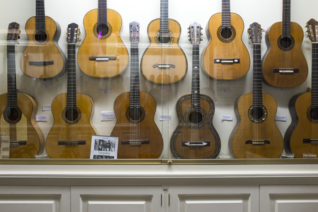 Seville, Spain - May 31th, 2019: Casa de la Guitarra. Flamenco guitar display cases exhibition