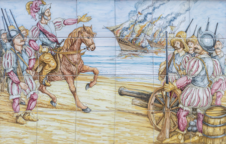 Badajoz, Spain - April 24th, 2019: Hernan Cortes burns his vessels arriving Mexico. Conquest of Aztec Empire scene. Glazed tiles wall