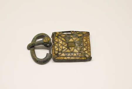 Malaga, Spain - Sept 21th, 2018: Visigothic belt plate and buckle decorated with cloisonne vitreous paste. Malaga Museum, Spain Editorial