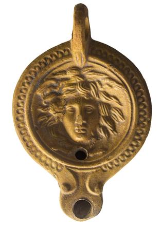 Cordoba, Spain - December 7th, 2018: Roman clay oil lamp decorated with Medusa head, Archaelogical Cordoba Museum, Spain