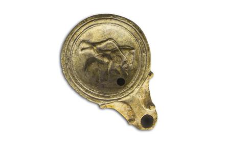 Cordoba, Spain - December 7th, 2018: Roman clay oil lamp decorated with horseman, Archaelogical Cordoba Museum, Spain