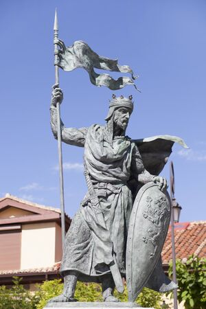Leon, Spain - June 25th, 2019: Alfonso IX, 12th Century king of Leon and Galicia. Monument at Santo Martino square, Leon, Spain. Sculpted by Estanislao Garcia Olivares Editorial