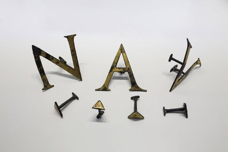 Malaga, Spain - Sept 21th, 2018: Roman set of letters and punctuation marks made of gilded bronze at Malaga Museum, Spain Stock Photo