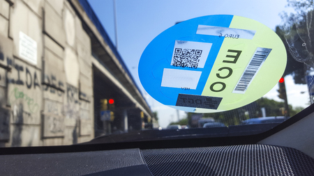 Madrid, Spain - 14th july, 2019: Madrid Central sticker in car windshield. City center off-limits identification to traffic
