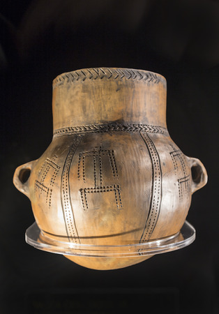Cabra, Spain - May 19th, 2019: Vessel decorated with anthropomorphous motifs from Prado Negro, Granada, Spain. Replica at Cabra Archaeoligical Museum 新聞圖片