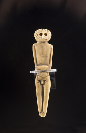Cabra, Spain - April 19th, 2019: Chalcolithic anthropomorphous idol of Valencina de la Concepcion, Seville. Representation of deities made of bones at Archeological Museum of Cabra. Reproduction
