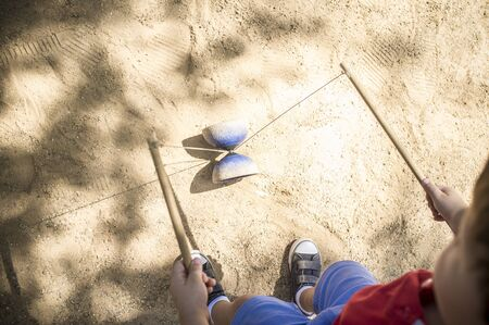 Little boy learning to use diabolo i the park. Classic games for children concept 写真素材