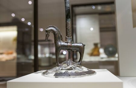 Madrid, Spain - November 10, 2017: Calaicete Censer or thymiaterion stand. 6th Century BC bronze piece from Teruel, Spain. National Archaeological Museum