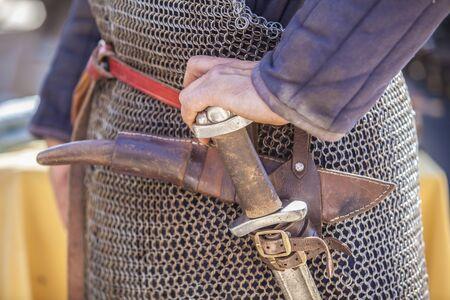 Waist dagger-holder with sword. Medieval warrior equipment