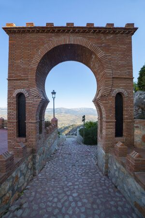 Velez-Malaga gate at Comares village, Malaga, Spain. Through this horseshoe arch was controlled the entry from the north east and the water route.