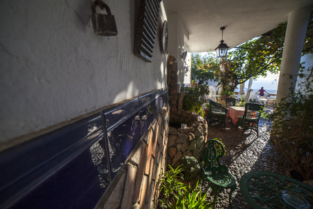 Comares, Spain - Sept 23th, 2018: Courtyard of Molino De Los Abuelos Hotel, built with typical axarquia architecture. Comares, Malaga Province, Andalusia, Spain Editorial