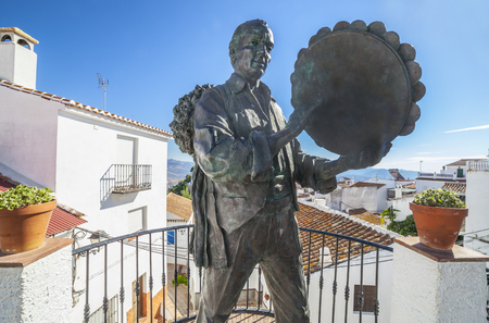 Comares, Spain - Sept 23th, 2018: Statue of the musician Antonio Gallego in Comares, Malaga, Spain. Famous performer of Verdiales Folk Music