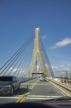 Ayamonte, Spain - Oct 13th 2018: Driving through Guadiana International Bridge, Ayamonte, Spain. View from the inside of the car