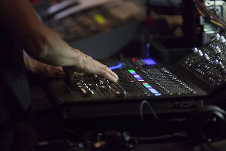 Console controller hand working during theatre play. Light music console on live performance. Soft noise Reklamní fotografie