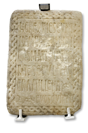 Seville, Spain - July 7th, 2018: Mozarabic marble tombstone carved with epitaph, 11th Century AC. Archaeological Museum of Seville, Andalusia, Spain