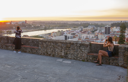 Coimbra, Portugal - Sept 6th 2019: Two women enjoy the sunset from viewpoint at Coimbra UpTown, Portugal Editorial