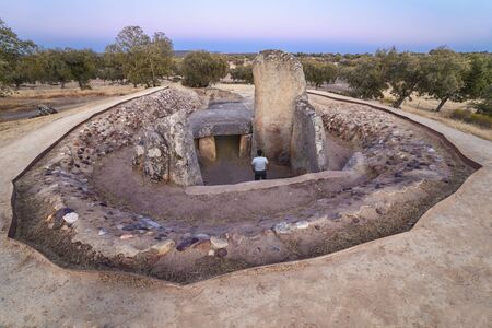 Visitor at burial chamber of Dolmen of Lacara. The biggest megalithic burial in Extremadura, Spain