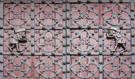 Porters of La Ribera or Bastaixos transporting stones. Represented on the doors of the main entrance of Santa Maria del Mar, Barcelona, Spain. Outdoors Reklamní fotografie
