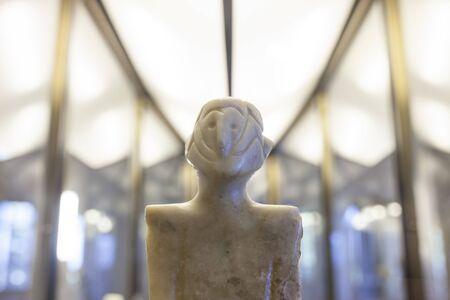 Badajoz, Spain - Jan 28th, 2018: Anthropomorphous idol of Rena, Badajoz. Representation of deity belong to Chalcolithic period at Archeological Museum of Badajoz Editorial