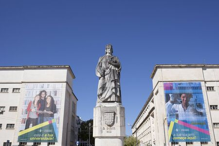 Coimbra, Portugal - Sept 6th 2019: Statue of Denis of Portugal at the University of Coimbra