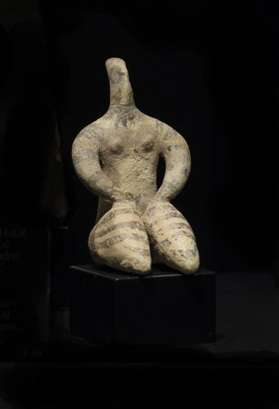 Malaga, Spain - March 2nd, 2019: Neolithic Venus of Halaf Culture representing mother Goddess. Terracotta 6100-5400 BC. Ifergan collection Editorial