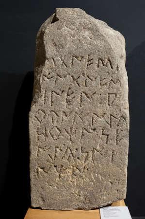 Barcelona, Spain - Dec 27th, 2019: Stela bearing an Iberian inscription. Iberia Culture, 2nd BC. Catalan Museum of Archaeology, Barcelona, Spain 報道画像